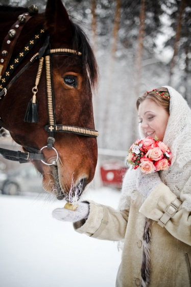 The bride give the horse some food