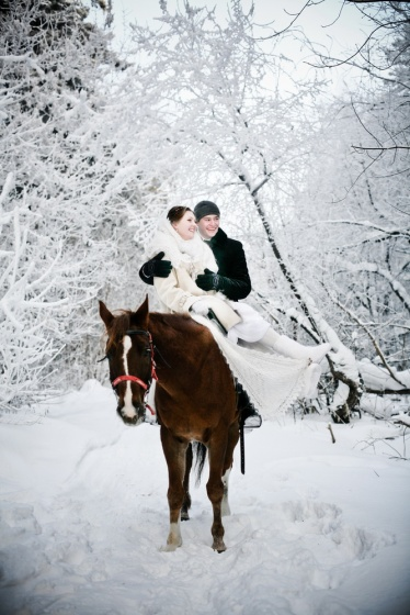 Just married in a winter forest