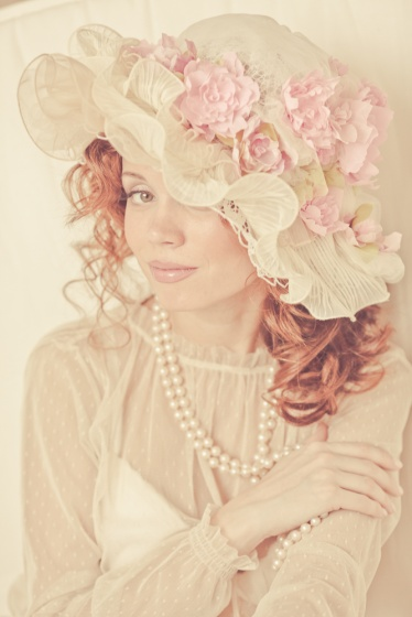 Modern style bridal bonnet with a flowers
